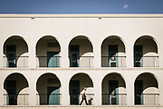 A cadet walks along third division as the moon sets over the back of Padgett-Thomas Barracks on Friday, September 11, 2020.<br /> <br /> Credit: Cameron Pollack / The Citadel