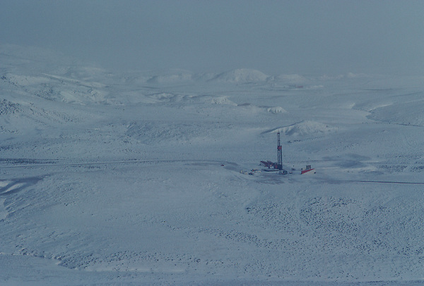 Stock photo of an aerial view of an on-shore rig at a snow covered worksite