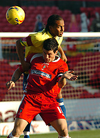 Photo: Kevin Poolman.<br />Swindon Town v Hereford United. Coca Cola League 2. 04/11/2006. Lee Peacock of Swindon and Tamika Mkandawire of Hereford fight over a header.
