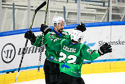 Nik Simsic and Guillaume Leclerc of HK SZ Olimpija celebrate after scoring a goal during ice hockey match between HK SZ Olimpija Ljubljana and HC Orli Znojmo in bet-at-home ICE Hockey League, on October 17, 2021 in Hala Tivoli, Ljubljana, Slovenia. Photo by Morgen Kristan / Sportida