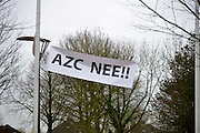 Nederland, the Netherlands, Geldermalsen, 18-12-2015Tegenstanders van de opvang voor vluchtelingen, azc, hebben spandoeken en protestleuzen in het dorp opgehangen. Na een geweldadige demonstratie afgelopen woensdag is het besluit de besluitvorming, uitgesteld.Geldermalsen, the Netherlands,Demonstration, protest, against the sheltering in a tentcamp near Geldermalsen. In Holland the growing number of refugees forces the government to house them in big centers. Some citizens do not approve and made a violent protest last wendsday.FOTO: FLIP FRANSSEN