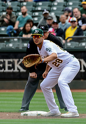 April 18, 2018 - Oakland, CA, U.S. - OAKLAND, CA - APRIL 18: Oakland Athletics first baseman Matt Olson (28) stands ready at 1st base for a pick during the game between the Chicago White Sox verses the Oakland Athletics on Wednesday, April 18, 2018 at O.co Stadium in Oakland, CA (Photo by Douglas Stringer/Icon Sportswire) (Credit Image: © Douglas Stringer/Icon SMI via ZUMA Press)