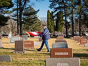 22 NOVEMBER 2019 - DES MOINES, IOWA: RICHARD SCHWERDTFEGER, a Vietnam era US Air Force veteran, carries the Gold Star flag to the grave side service for Marine Corps Reserve Private Channing Whitaker. Whitaker died in the Battle of Tarawa on Nov. 22, 1943 during World War Two. He was buried on Betio Island, in the Gilbert Islands, and his remains were recovered in March 2019. He was identified by a DNA match with surviving family members in Iowa. Whitaker was reintered in the Glendale Cemetery in Des Moines exactly 76 years after his death in World War Two. About 1,000 US Marines and sailers were killed in four days during the Battle of Tarawa.           PHOTO BY JACK KURTZ
