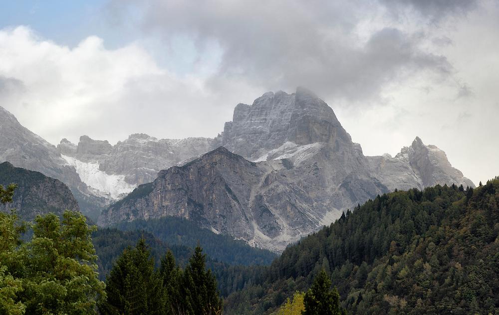 Dolomite mountain breaking through the cloud.