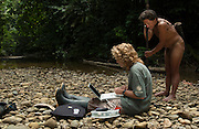 Huaorani Indian (Pirahua) & Reneé Bish<br /> Indigenous Rain Forest Tribe<br /> Napo Province<br /> ECUADOR.  South America