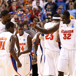 Mar 19, 2011; Tampa, FL, USA; Florida Gators players celebrates a win over the UCLA Bruins in the third round of the 2011 NCAA men's basketball tournament at the St. Pete Times Forum. Florida defeated UCLA 73-65.  Mandatory Credit: Derick E. Hingle