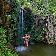 people, waterfall, Kauai, Hawaii, USA<br />