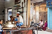 A man serving Nihari (a meat stew) at the Haji-Shabrati Nihari wallah