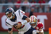 San Francisco 49ers linebacker Nick Bellore (50) sacks Houston Texans quarterback Tom Savage (3) at Levi's Stadium in Santa Clara, Calif., on August 14, 2016. (Stan Olszewski/Special to S.F. Examiner)