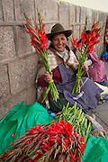 Quechua woman, selling flowers, San Pedro Market, Cusco, Urubamba Province, Peru