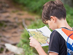 Girl looking at map in black forest, Feldberg, Baden-Württemberg, Germany