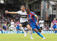 Football - 2018 / 2019 Premier League - Fulham vs. Crystal Palace<br /> <br /> Wilfried Zaha (Crystal Palace) takes on Calum Chambers (Fulham FC) at Craven Cottage<br /> <br /> COLORSPORT/DANIEL BEARHAM