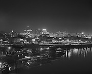 Ackroyd-14186-1. Downtown Portland looking west from the Marquam Bridge. The Hawthorne Bridge may be seen at right foreground. Principal buildings from left include the Standard Plaza with its weather beacon on top, the Hilton Hotel and the Public Service Building brightened by its roof-top Pacific Power and Light Co. sign. October 3, 1966.
