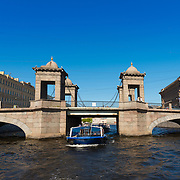 Tour Boat Under Lomonosov Bridge In Fontanka River, St Petersburg
