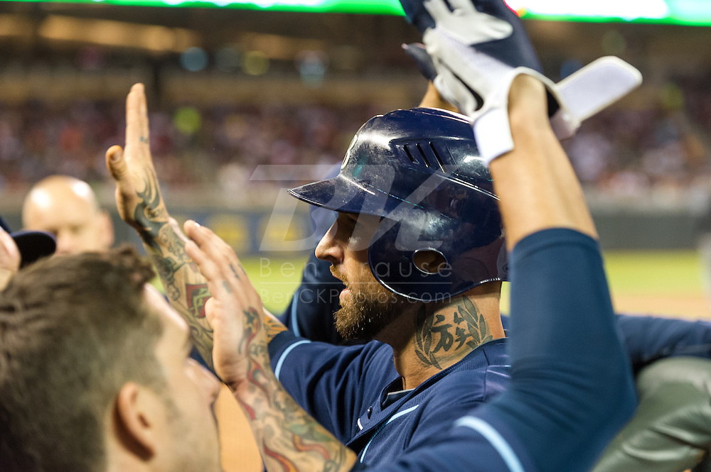 Ryan Roberts (19) is congratulated in the dugout during a game against the Minnesota Twins on August 10, 2012 at Target Field in Minneapolis, Minnesota.  The Rays defeated the Twins 12 to 6.  Photo: Ben Krause