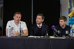 LIVERPOOL, ENGLAND - Thursday, March 12, 2015: Liverpool's Jamie Carragher and captain Steven Gerrard (R) with broadcaster Peter McDowell (C) announce plans for an All-Star Charity friendly match to be played at Anfield on Sunday March 29th in aid of the Liverpool FC Foundation. (Pic by Paul Currie/Propaganda)