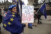 Anti Brexit protester with a placard reading Show us the Russia Report which alludes to the allegation of Russian interference in the EU referendum in Westminster outside Parliament on 8th January 2020 in London, England, United Kingdom. With a majority Conservative government in power and Brexit day at the end of January looming, the role of these protesters is now to demonstrate in the hope of the softest Brexit deal possible.