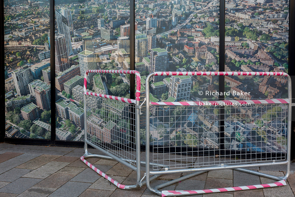 As the number of UK Coronavirus cases rose to over 8,000, it was announced that thousands of 15-minute home tests could be made available within days to those self-isolating with symptoms. A barrier surrounds an image of the Elephant & Castle development (aka Elephant Park), on 25th March 2020, in London, England.