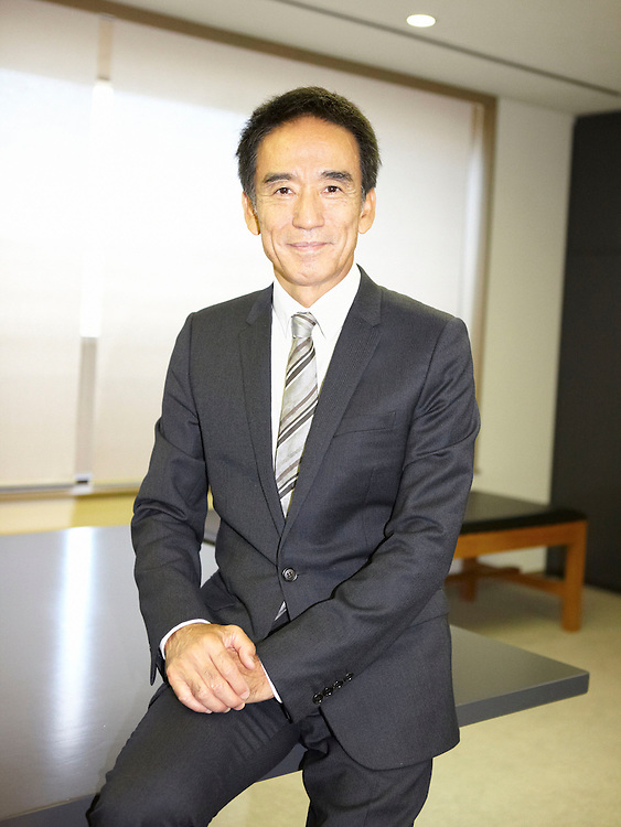 Portrait photograph of Oriental CEO in office
