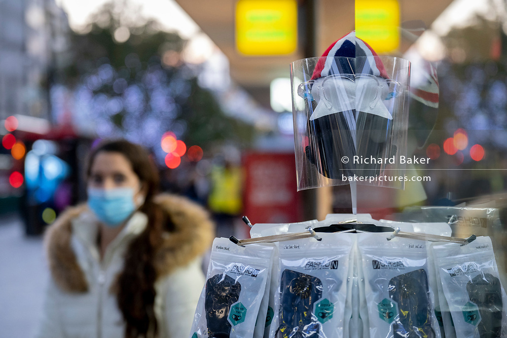 As the UK reacts to Prime Minister Boris Johnson's announcement of Lockdown 2 during the second wave of the Coronavirus pandemic, face shields and masks are on sale in a window of a retailer on Oxford Street, on 2nd November 2020, in London, England. From midnight on Thursday, all non-essential shops, bars, restaurants and other small businesses will have to closed, according to government Covid restrictions - and for a minimum of 4 weeks in the run-up to Christmas.