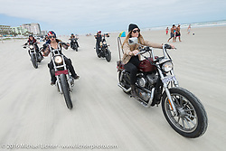 Kissa Von Addams, Tracy Herndon and the Iron Lillies on the beach for the Hot Leathers ride during the Daytona Bike Week 75th Anniversary event. FL, USA. Tuesday March 8, 2016.  Photography ©2016 Michael Lichter.
