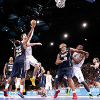 15 July 2012: Pau Gasol of Team Spain goes for the skyhook over Ronny Turiaf while Boris Diaw vies for the rebound with Serge Ibaka during a pre-Olympic exhibition game won 75-70 by Spain over France, at the Palais Omnisports de Paris Bercy, in Paris, France.