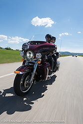 Gordon and Sherri Bridges of Lincoln, NE on their 2015 Ultra Glide riding from Steamboat Springs to Doc Holliday's Harley-Davidson in Glenwood Springs during the Rocky Mountain Regional HOG Rally, Colorado, USA. Thursday June 8, 2017. Photography ©2017 Michael Lichter