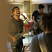A rock band rehearsing.