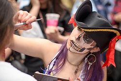 October 29, 2016 - Sydney, NSW, Australia - A makeup artist dressed as a zombie during the Sydney Zombie Walk on October 29, 2016 in Sydney, Australia. Hundreds of people gathered today dressed as zombies for the 6th edition of the Sydney Zombie Walk in support of 'The Brain Foundation' (Credit Image: © Hugh Peterswald/Pacific Press via ZUMA Wire)