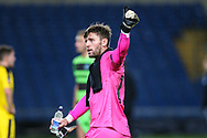 Forest Green Rovers goalkeeper James Montgomery gives a thumbs up to the supporters during the The FA Cup 1st round match between Oxford United and Forest Green Rovers at the Kassam Stadium, Oxford, England on 10 November 2018.