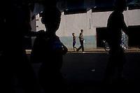 cubans walking through havana streets