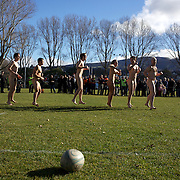 The 'Nude Blacks' warming up before the start of the 'Nude Blacks' versus a Fijian invitation side played at Logan Park, Dunedin as an unofficial curtain raiser match before the New Zealand V Fiji test match in Dunedin, New Zealand...The 'Nude Blacks' won the match 20-10 with 21 year old female player Rachel Scott, a member of the Otago women's rugby team named player of the day. .Over 500 people turned up to watch the match which included a blind referee, Julie Woods and three clothed streakers who were ejected from the playing area..The 'Nude Blacks' traditionally play games before test matches in Dunedin and were using this match as a warm up for three nude games planned during the IRB Rugby World Cup in New Zealand with teams from Argentina, Italy, England and Ireland involved.  Matches will be played before World Cup games in Dunedin. New Zealand. 22nd July 2011. Photo Tim Clayton