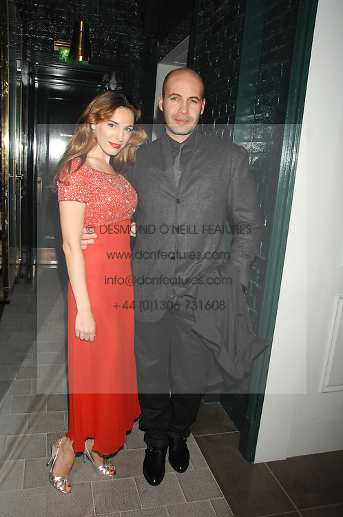 KELLY BROOK and BILLY ZANE at a party to launch the Dom Perignon OEotheque 1995 held at The Landau, Portland Place, London W1 on 26th February 2008.<br />