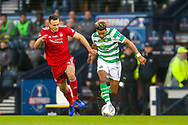 Scott Sinclair (#11) of Celtic dribbles the ball towards goal under pressure from Andrew Considine (#4) of Aberdeen during the Betfred Cup Final between Celtic and Aberdeen at Celtic Park, Glasgow, Scotland on 2 December 2018.