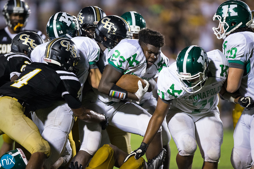 EJ Henderson (23) of the A.L. Brown Wonders loses his helmet as he is hit by several Concord Spiders defenders during second half action at Robert C. Bailey Stadium August 18, 2016, in Concord, North Carolina.  The Wonders defeated the Spiders 31-19.  (Brian Westerholt/Special to the Tribune)
