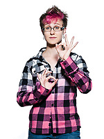 Portrait of a young serene Woman making hand gesture ok sign  in studio on white isolated background