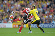Graziano Pelle of Southampton kicks the ball over Valon Behrami of Watford. Barclays Premier League, Watford v Southampton at Vicarage Road in London on Sunday 23rd August 2015.<br /> pic by John Patrick Fletcher, Andrew Orchard sports photography.