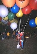 John Ninomiya, a cluster balloonist gets help from voluteers at Coalinga, California.