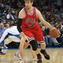 04 February 2009:  Chicago Bulls forward Andres Nocioni (5) drives past New Orleans Hornets forward Ryan Bowen (40) during a 93-107 loss by the New Orleans Hornets to the Chicago Bulls at the New Orleans Arena in New Orleans, LA.
