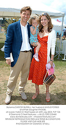 Ballerina DARCEY BUSSELL, her husband ANGUS FORBES and their daughter PHOEBE, at a polo match in West Sussex on 20th July 2003.PLP 106