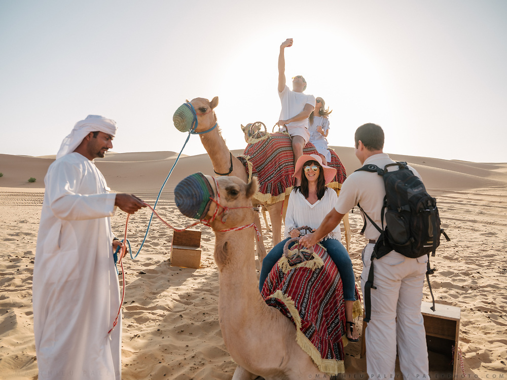 Tourists go on a camel ride in the Liwa desert, at the luxurious Qasr Al Sarab resort. Set in the middle of the Rub' al Khali or Empty Quarter, the largest uninterrupted sand mass in the world, Qasr Al Sarab Desert Resort by Anantara is isolated from the outside world, but only 200km away from Abu Dhabi.