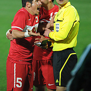 Referee's Sergii BOIKO (R) and Turkey's Emre BELOZOGLU (L) during their International friendly soccer match Turkey between South Korean at the Avni Aker stadium in Trabzon, Turkey on Wednesday 09 February 2011. Photo by TURKPIX