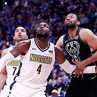 01 April 2018: Milwaukee Bucks forward Jabari Parker (12) vies for the rebound with Denver Nuggets forward Paul Millsap (4) and Denver Nuggets forward Trey Lyles (7) during the Denver Nuggets 128-125 victory over the Milwaukee Bucks, at the Pepsi Center, Denver, Colorado, USA.