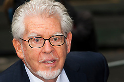 London, May 28th 2014. Veteran entertainer Rolf Harris arrives at Southwark Crown Court with his wife Alwen, his daughter Bindi and his niece Jenny as he continues to defend himself against 12 charges of indecent assault he is alleged to have committed against four girls aged 7 to 19.