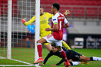 PIRAEUS, GREECE - FEBRUARY 25: Pierre-Emerick Aubameyang of Arsenal FC scores the third goal of his team during the UEFA Europa League Round of 32 match between Arsenal FC and SL Benfica at Karaiskakis Stadium on February 25, 2021 in Piraeus, Greece. (Photo by MB Media)