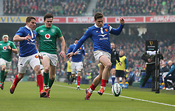 France's Damian Penaud kicks the ball into touch during the Guinness Six Nations match at the Aviva Stadium, Dublin.
