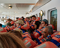 Mandatory lifeboat drill aboard the MV World Odyssey. The students, life long learners, faculty, and staff were required to repeat the drill once a month during the 102 day Spring 2016 voyage. Once the drill was completed, we were cleared to depart Encenada for Hilo, Hawaii. Image taken with a Nikon 1 V3 camera and 10-30 mm lens (ISO 200, 10 mm, f/3.5, 1/25 sec).