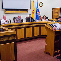 Members of the Gallup City Council listen to a presentation by Jon DeYoung during the city council meeting at Gallup City Hall Tuesday.
