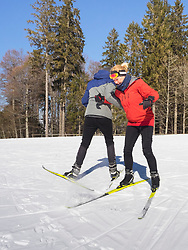 Young woman learning cross country skiing course with female teacher, Black-Forest, Baden-Wuerttemberg, Germany