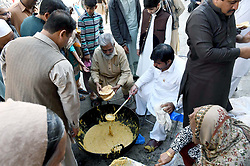 November 21, 2018 - Pakistan - RAWALPINDI, PAKISTAN, NOV 22: Different food items being are preparing for distribute .among devotees during celebration religious procession in connection of Birthday Ceremony of .Holy Prophet on the occasion of 12th Rabi-ul-Awwal, in Rawalpindi on Thursday, November .22, 2018. (Credit Image: © PPI via ZUMA Wire)